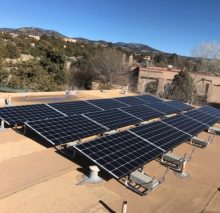 15-panel system on a flat roof in the foothills of Santa Fe.